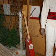 Why did the voyageurs use canoe paddles that were red?